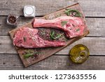 raw beef tomahawk steak with... | Shutterstock . vector #1273635556