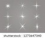 white glowing light explodes on ... | Shutterstock .eps vector #1273647340