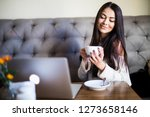 young pretty woman in a cafe...   Shutterstock . vector #1273658146