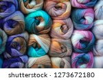 Small photo of background of colored wool skein. yarn skein, colorful thread in skeins, Red yellow blue pink purple yarn collection