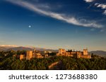 blue sky and moon over hilltop... | Shutterstock . vector #1273688380