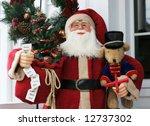 santa statue holding toys - stock photo