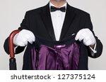 a butler holding a wool coat... | Shutterstock . vector #127375124