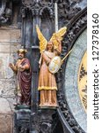 Small photo of Magus and archangel Michael figures on Prague Astronomical Clock