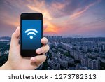 smart phone in hand and using... | Shutterstock . vector #1273782313