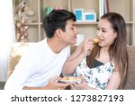 sweet couple eating cooking and ... | Shutterstock . vector #1273827193