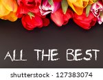 Bunch of tulips with blackboard: all the best - stock photo