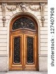 old wooden door in paris... | Shutterstock . vector #127407908
