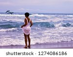 a girl in a white dress stands... | Shutterstock . vector #1274086186