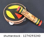 """Small photo of Close-up of two handmade Brazilian percussion instruments: pandeiro (tambourine) and """"ganzá"""", a type of rattle. They are widely used to accompany the samba music."""