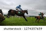 race horses and jockeys jumping ... | Shutterstock . vector #1274357659