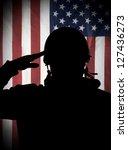 American (USA) soldier saluting to USA flag - stock photo