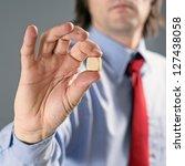 Businessman holding gambling dice, business gambling concept. - stock photo