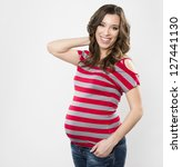 smiling happy young pregnant... | Shutterstock . vector #127441130