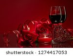 Stock photo still life with roses red hearts and two glasses with wine on a red background valentine s day 1274417053