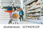at the supermarket  man pushes... | Shutterstock . vector #1274425129