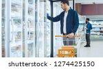 at the supermarket  handsome... | Shutterstock . vector #1274425150
