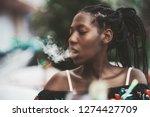 portrait of a dazzling african...   Shutterstock . vector #1274427709