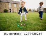 children runnning as they... | Shutterstock . vector #1274435269