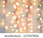 Pastel Heart Bokeh On A Pale...