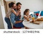 family breakfast.young parents... | Shutterstock . vector #1274481946