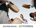 A Group Of Men Perform A...