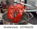 A Cooked Lobster Being Lifted...