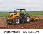 plow the field for sowing...   Shutterstock . vector #1274683696
