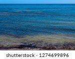 dark mineral ilmenite... | Shutterstock . vector #1274699896