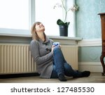 portrait of a woman relaxing at ... | Shutterstock . vector #127485530