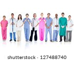 happy team of doctors standing...   Shutterstock . vector #127488740