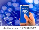smartphone with new wifi 6 on... | Shutterstock . vector #1274905519