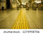 tactile paving to assist the... | Shutterstock . vector #1274958706