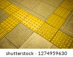 tactile paving to assist the... | Shutterstock . vector #1274959630