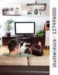 young couple relaxing  watching ... | Shutterstock . vector #127496000