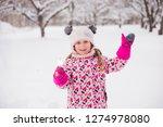 kid girl 5 6 year old holding...   Shutterstock . vector #1274978080