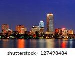 Stock photo boston city skyline at dusk with prudential tower and urban skyscrapers over charles river with 127498484