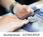 selective focus phone in hand... | Shutterstock . vector #1275015919