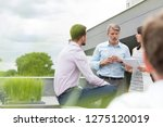 professionals discussing over...   Shutterstock . vector #1275120019