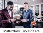 attire with tie. rich... | Shutterstock . vector #1275146176