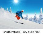 young man skiing on piste.... | Shutterstock . vector #1275186700