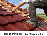 tiling a roof | Shutterstock . vector #1275191956