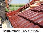tiling a roof | Shutterstock . vector #1275191959