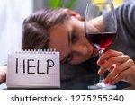 female alcoholism concept.... | Shutterstock . vector #1275255340