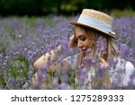 charming blonde girl in a straw ... | Shutterstock . vector #1275289333