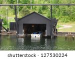 Boat Garage at Laurentians Mountains Lake in Quebec , Canada - stock photo