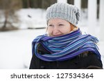 Wrapped in warm scarf woman looking at distance - stock photo