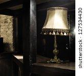 Old in retro style lamp lightning dark room - stock photo