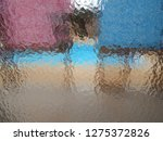 distorted by pebbled glass   an ... | Shutterstock . vector #1275372826