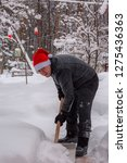 A Man Cleans Steps From Snow....